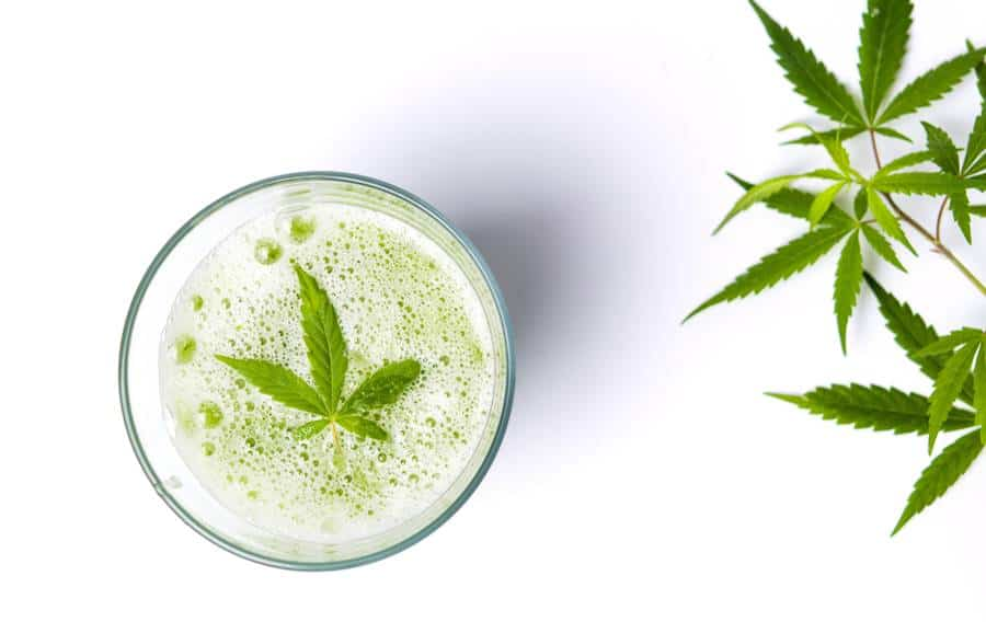 cbd oil and alcohol - cocktail with hemp leaf in it
